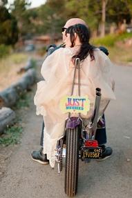 biker bride into sunset
